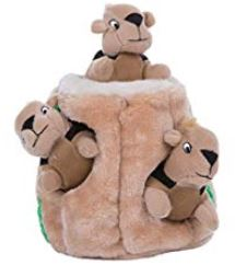 Outward Hound's mentally stimulating dog puzzle toy with squirrels in a log