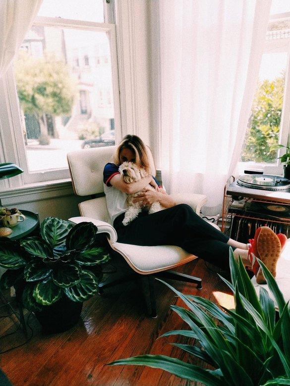 depressed woman hugging emotional support dog