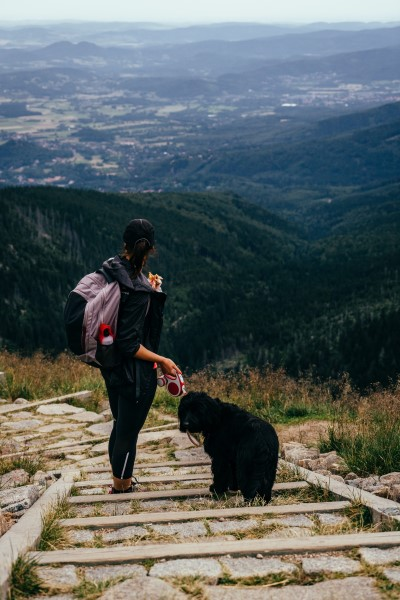 women and dog on hike to relieve stress