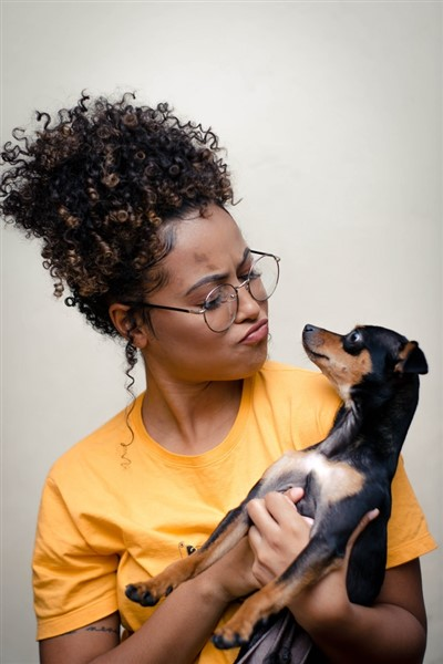 woman wondering how can i deworm my dog naturally by Wallace Chuck