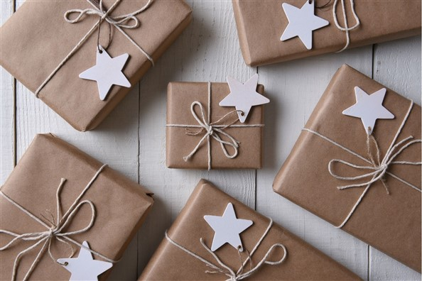 best Gifts for Dog Lovers wrapped in brown paper and twine