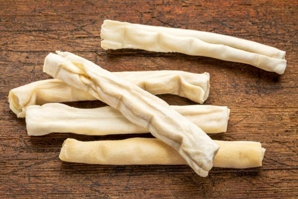 pile of rawhide sticks that are bad for dogs